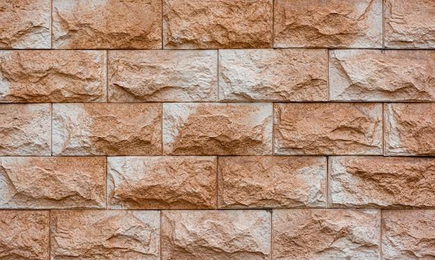 Fundo de parede de tijolo bege áspero