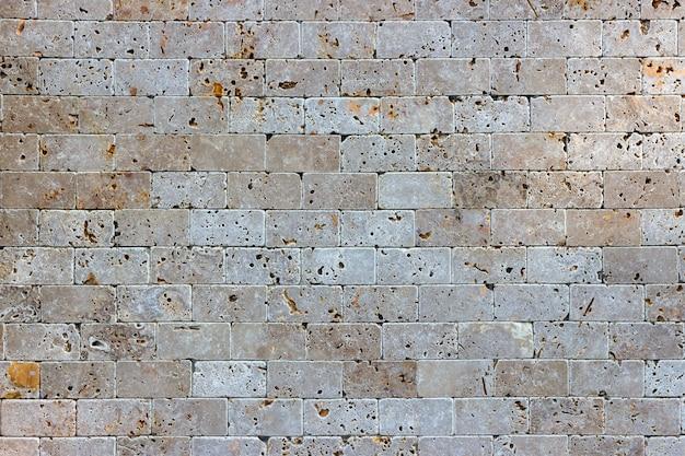 Fundo de parede de tijolo de rocha de concha de areia