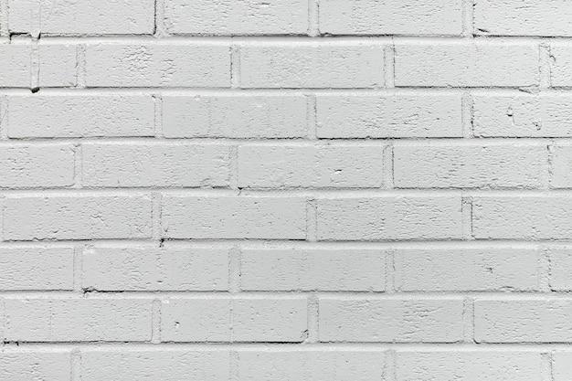 Fundo de parede de tijolo pintado de branco