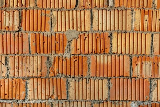 Fundo de parede de tijolo vermelho de alvenaria, textura de parede