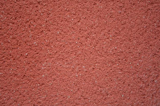 Fundo de parede granulado cor granada