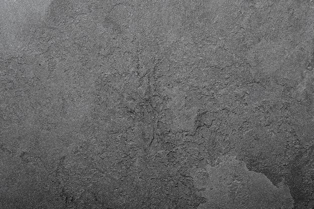 Fundo de parede texturizado, espaço de cópia cinza escuro, tinta de gesso irregular e desbotada, elemento de design