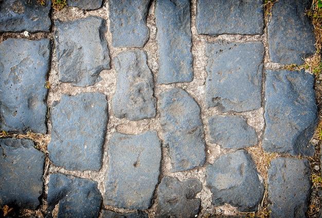 Fundo de pavimento de paralelepípedos de granito