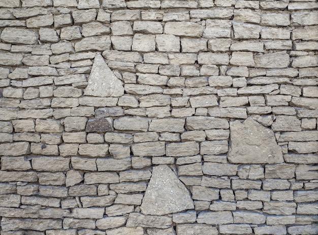 Fundo de pedra decorativa. fundo de alvenaria. velho muro de pedra. Foto Premium
