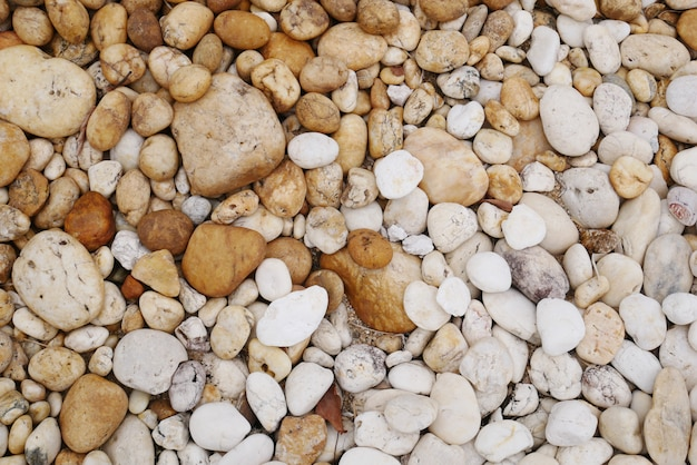 Fundo de pedra marrom praia de seixo