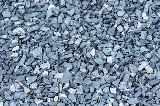 Fundo de pedra preta pequena estrada, seixos de cascalho escuro textura de pedra textura perfeita granito mármore
