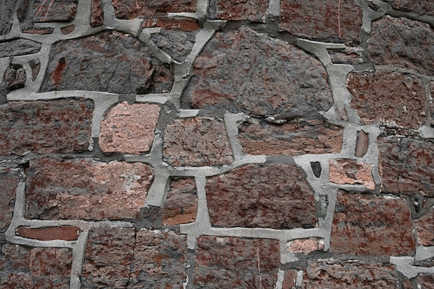 Fundo de pedras antigas de granito com concreto