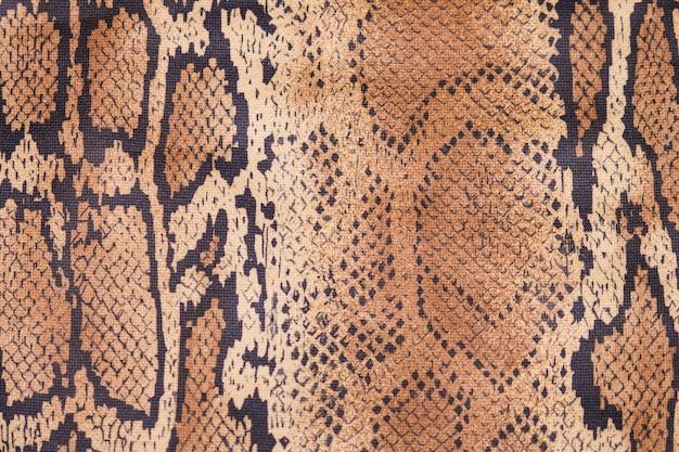 Fundo de pele de cobra, close-up, textura bege e marrom