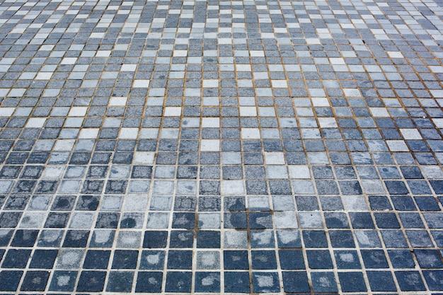 Fundo de pequenos azulejos azuis irregulares.