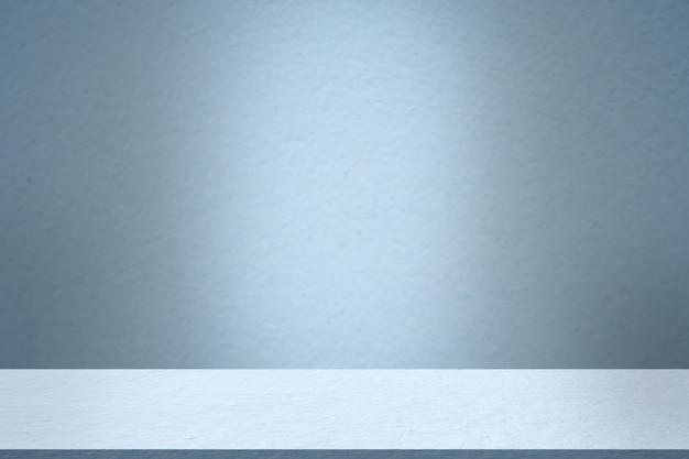Fundo de piso de cimento de sala de estúdio azul vazio. cenário de exibição de montagem de interiores de prateleira de mesa. em branco texturizado construção concreto material áspero escuro interior. espaço livre para apresentação de produtos.
