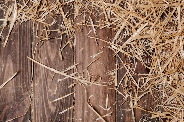 Fundo de piso de madeira e palha seca