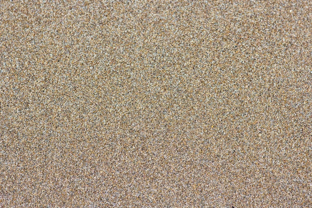 Fundo de praia de areia. textura de areia detalhada, vista superior