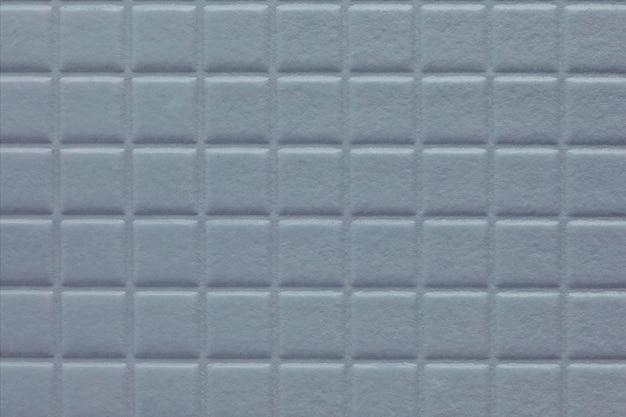 Fundo de quadrados com textura macia, parede de livro de caderno na cor azul metálico
