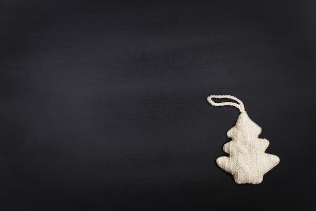 Fundo de quadro em branco com árvore de natal tricotada