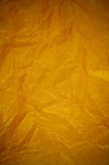 Fundo de reciclagem de papel dourado amassado.
