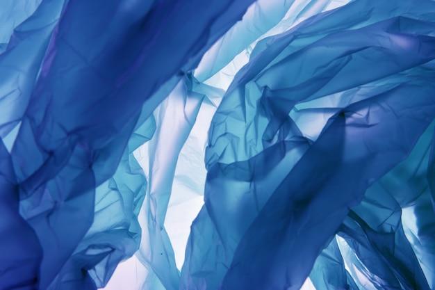 Fundo de saco de polietileno. ilustração azul abstrata. use como papel de parede ou para web design.