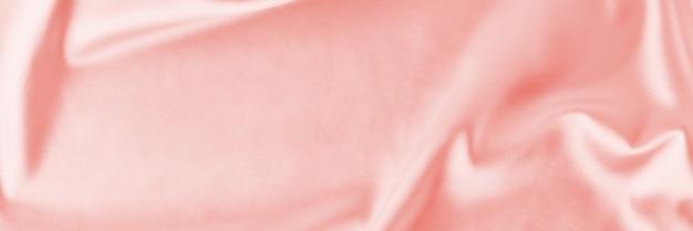Fundo de seda rosa claro com dobras