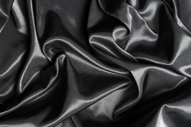 Fundo de superfície de tecido de seda preto