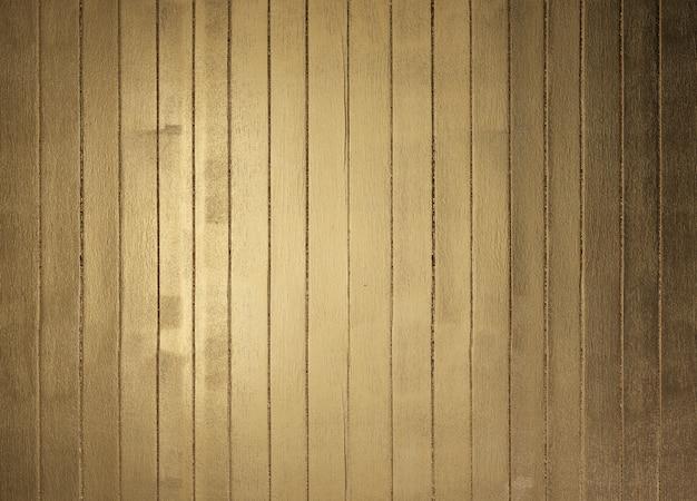 Fundo de tábuas de madeira pintada de ouro