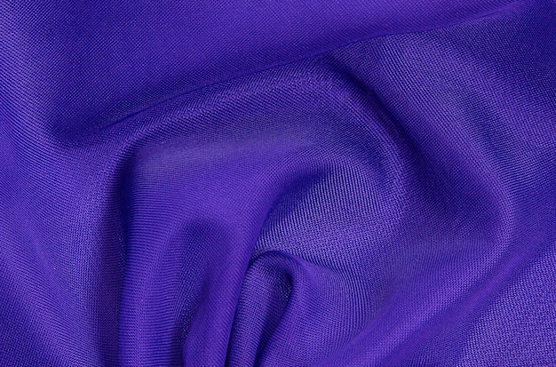 Fundo de tecido amassado púrpura, textura de tecido leve e arejado e transparente.