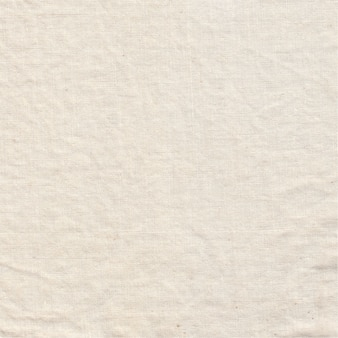 Fundo de tecido branco amassado, textura de pano creme