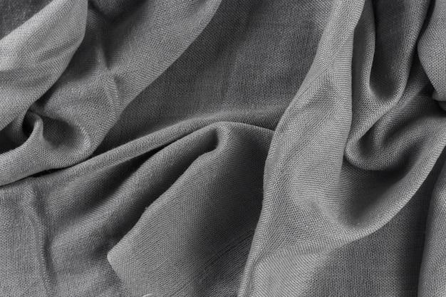 Fundo de tecido cinza texturizado amassado.