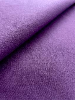 Fundo de tecido dobrado com textura de lona roxa