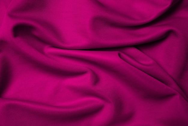 Fundo de tecido dobrado em seda roxa