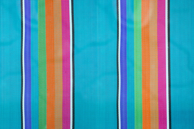 Fundo de tecido listrado colorido, textura de cadeira de praia dobrável