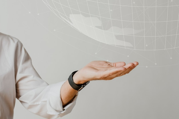 Fundo de tecnologia com a mão segurando o mundo digital