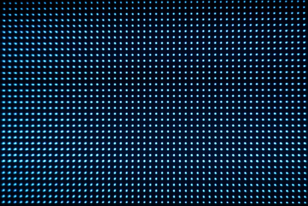 Fundo de tela digital. monitor de tela colorida ou tv com pixels e leds de perto.