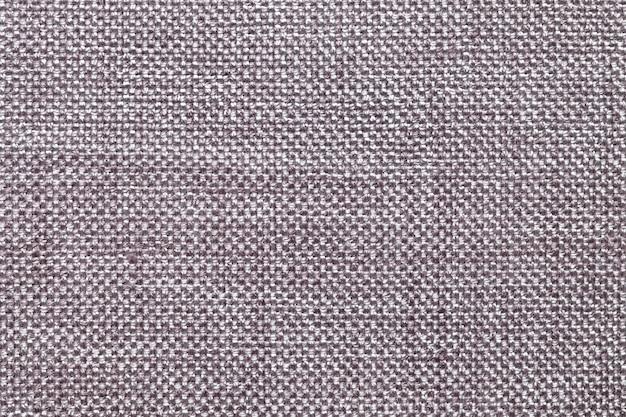 Fundo de têxteis cinza escuro com padrão quadriculada, closeup. estrutura da macro de tecido.