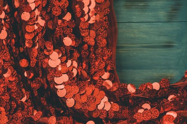 Fundo de têxteis de lantejoulas vermelhas. tecido com glitter. fundo vermelho