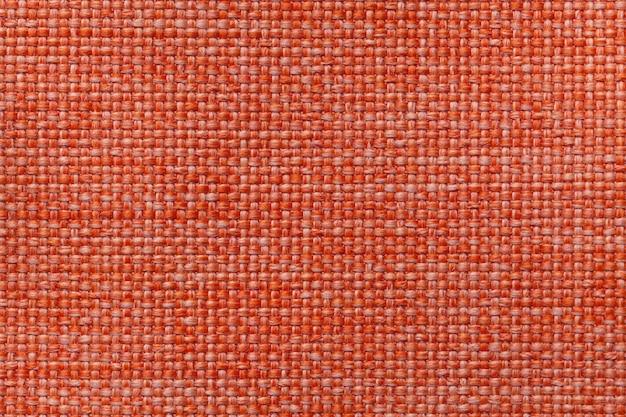 Fundo de têxteis laranja brilhante com padrão quadriculada, closeup. estrutura da macro de tecido.