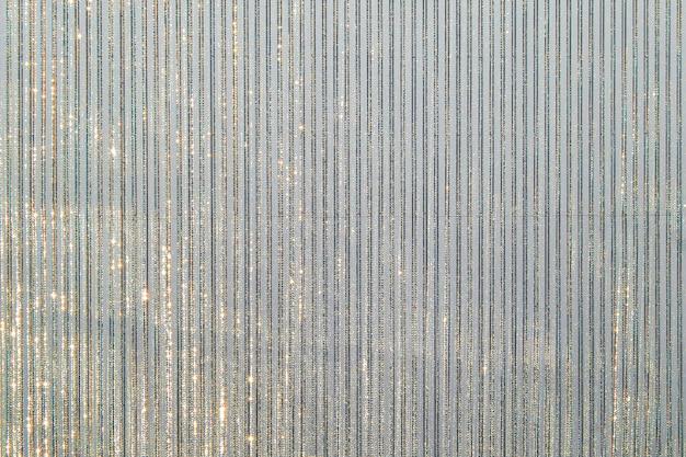 Fundo de têxteis metálicos