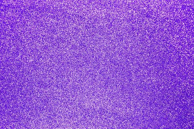Fundo de textura brilhante de glitter roxo