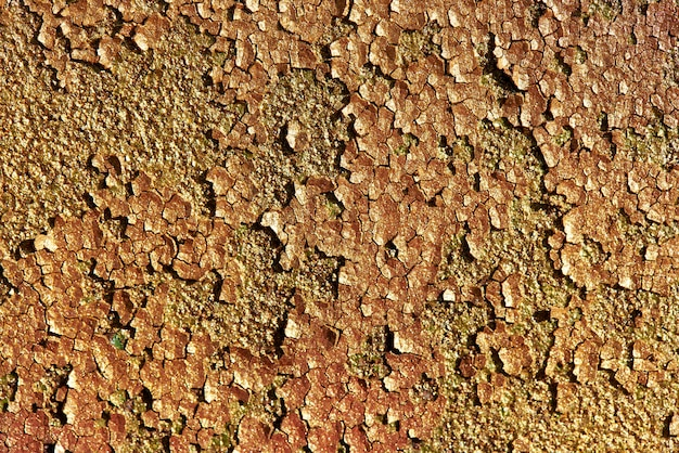 Fundo de textura brilhante glitter dourados. textura do fundo do metal oxidado velho com pintura rachada.