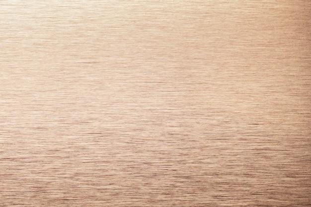 Fundo de textura de alumínio bronze claro. cenário de metal com textura de aço inoxidável cooper.