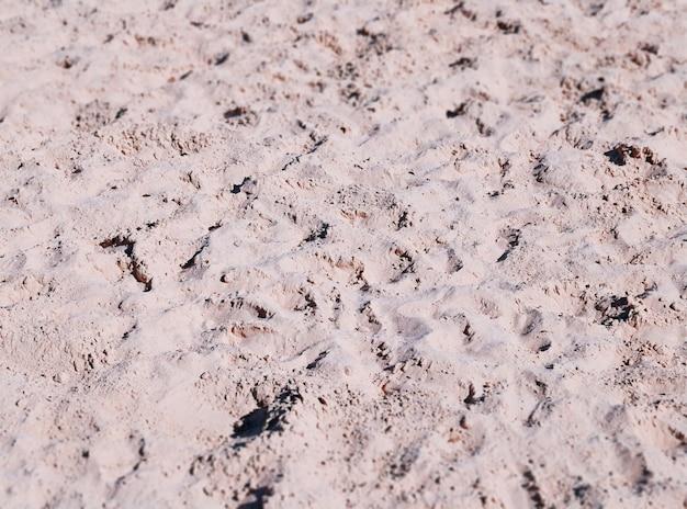 Fundo de textura de areia avermelhada de verão