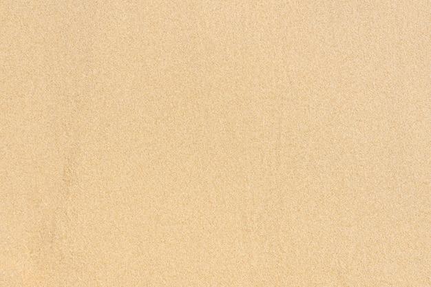 Fundo de textura de areia na praia. padrão de textura de areia bege clara do mar, fundo da praia de areia.