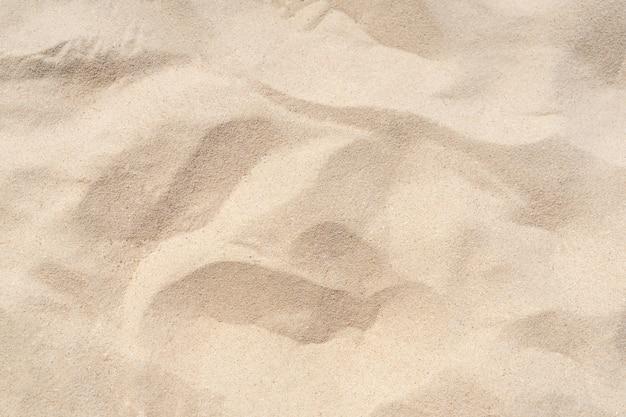 Fundo de textura de areia. padrão de deserto marrom de praia tropical. fechar-se.