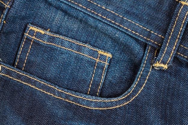 Fundo de textura de bolso de calça jeans azul, closeup