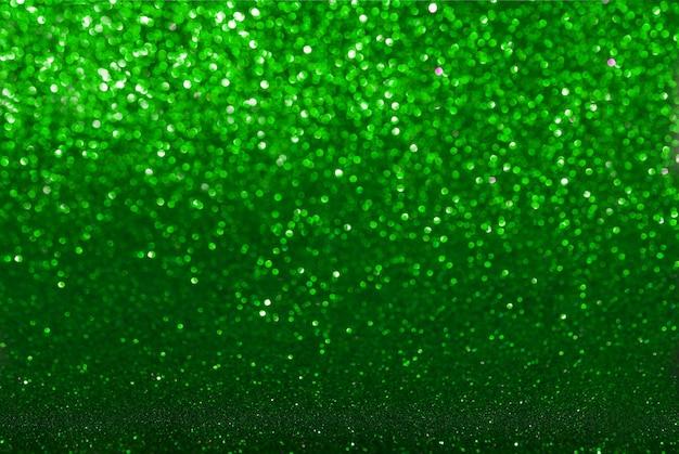 Fundo de textura de brilho verde. foco seletivo. esmeralda escura.