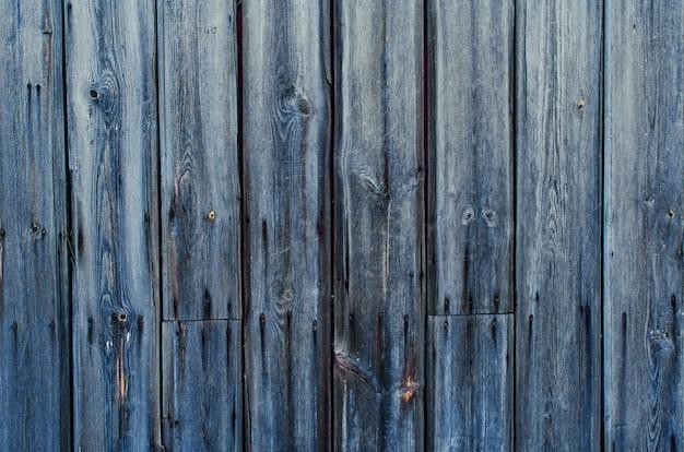 Fundo de textura de cerca de madeira rústica de cores verdes e azuis