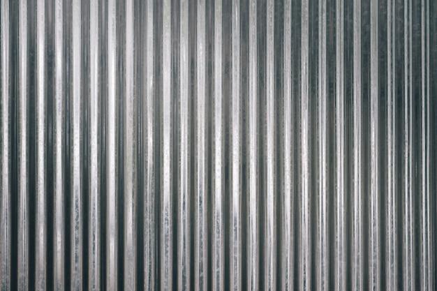 Fundo de textura de chapa galvanizada ondulada com luz de cima
