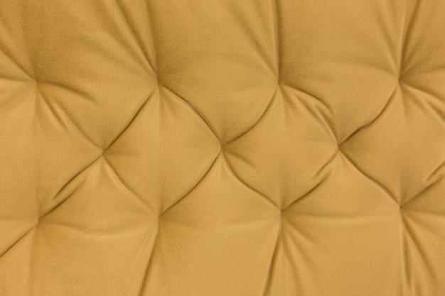 Fundo de textura de couro amarelo. design de pano de fundo de pele de vaca vintage.