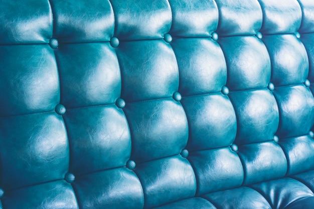 Fundo de textura de couro azul com padrão abotoado