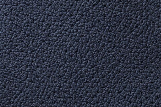 Fundo de textura de couro azul marinho perfurado