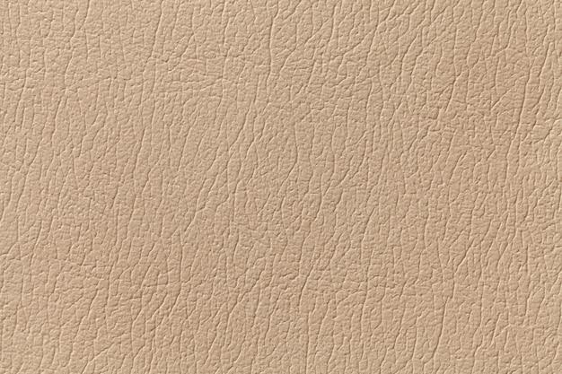 Fundo de textura de couro bege com padrão, closeup