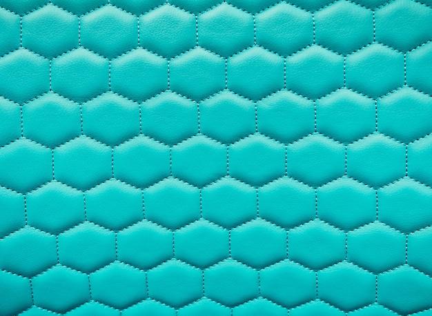 Fundo de textura de couro brilhante hexágono. favos de mel acolchoados